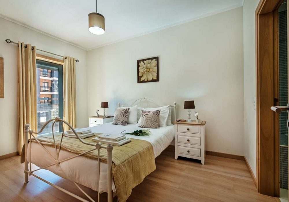 Well-furnished-master-bedroom-with-electric-shutters-and-air-conditioning